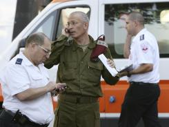 Israeli military and medical personnel talk in front of a hospital in the city of Burgas, Bulgaria, on Thursday.