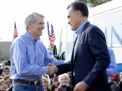 Mitt Romney is introduced by Sen. Rob Portman, R-Ohio, in Charleston, S.C., on Jan. 19.