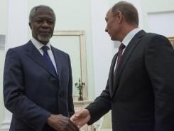 Russian President Vladimir Putin, right, shakes hands with United Nations special envoy Kofi Annan in Moscow on Tuesday.