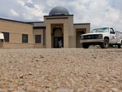 A worker walks out of the construction site of a mosque being built in Murfreesboro, Tenn., last month.