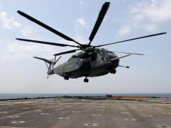 U.S. Navy photo shows an MH-53E Sea Dragon helicopter preparing to land. A similar helicopter crashed in Oman, the Navy said.