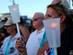 Less than 24 hours after 12 people were killed and dozens shot at a movie theater in Aurora, Colo., early Friday morning, a memorial is held for the victims.
