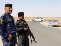 Iraqi soliders guard the Iraq-Syria border point, Albu Kamal, one of three between the two countries that a senior Iraqi official said were in the hands of the rebel Free Syrian Army.