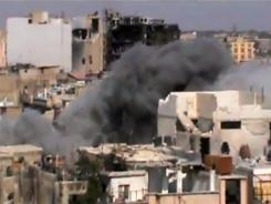 This image made from amateur video released by Shaam News Network purports to show shelling of Homs, Syria, by government forces on Saturday.