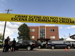Police surround the apartment of James Holmes, the suspect in the Colorado theater shooting on July 20.