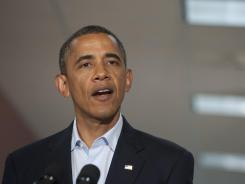 President Obama speaks Sunday at the University of Colorado Hospital in Aurora, Colo., following a visit with victims and family members of Friday's shootings.