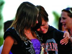 Memorial service for victim: Sadie Robinson, left, comforts Cecilia Alexander on Saturday.