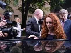 Rebekah Brooks, former chief executive of News International, and her husband, Charlie Brooks, right, leave Southwark Crown Court in London June 22 after attending a hearing in relation to the phone hacking scandal.