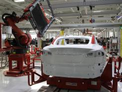 "Robot at work: A car assembly plant in Fremont, Calif. Global competition could be a matter of ""our robots"" vs. ""their robots."""