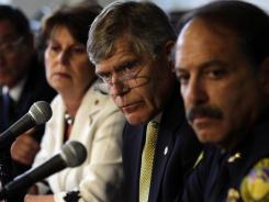 From left, Lilly Marks, executive vice chancellor of the University of Colorado Anschutz Medical Campus, Chancellor Don Elliman and Police Chief Doug Abraham speak during a news conference in Aurora, Colo.