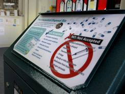 A bin collects unwanted drugs at United Pharmacy in Berkeley, Calif. Alameda County voted Tuesday on an ordinance regarding the disposal of unused medication.
