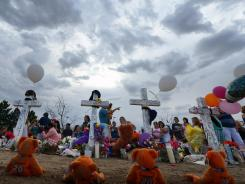 Thousands of people continue to visit the makeshift memorial for the 12 movie theater shooting victims built across the street from the Century 16 theater in Aurora, Colo.