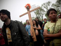 "A man holds a cross with a clown mask aloft during the National Atheist Organization's ""Reason Rally"" in March on the National Mall in Washington, D.C. A survey finds 19% of Americans say they have no religious affiliation."
