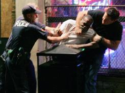 New Orleans police officers subdue a man on near Bourbon Street in the French Quarter in 2005.