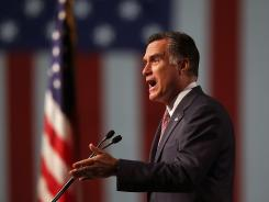 Mitt Romney speaks Tuesday during the 113th National Convention of the Veterans of Foreign Wars in Reno. On Wednesday, he begins a six-day trip to Britain, Israel and Poland.
