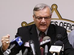 County Sheriff Joe Arpaio pounds his fist on the podium on May 10 as he answers questions regarding the Department of Justice's civil lawsuit.