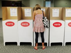 A lone voter marks her ballot at Precinct 111 in Oklahoma City, Okla., on June 26.