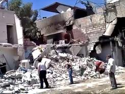 Image provided by Shaam News Network purportedly shows damage from shelling of a district of Damascus on Monday.