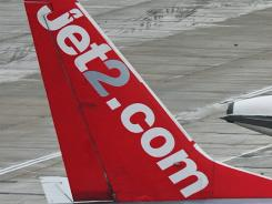 A Jet2.com plane sits on the tarmac in England.