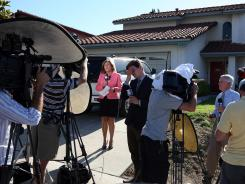 Television news crews set up for their live reports in front of the home of Robert and Arlene Holmes, parents of 24-year-old mass shooting suspect James Holmes, on July 20.