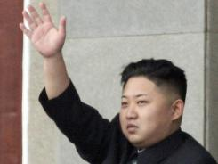 North Korean leader Kim Jong Un waves during a mass meeting of North Korea's ruling party at a stadium in Pyongyang in April.
