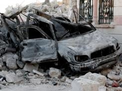 A damaged vehicle from clashes between Free Syrian Army soldiers and Syrian government troops at the border town of Azaz, about 20 miles north of Aleppo.