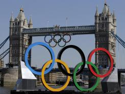 Olympic Rings hang from the Tower Bridge in London.