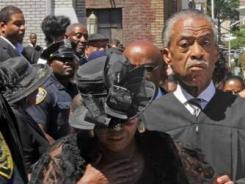 Bedelia Woods, the daughter of Sylvia Woods, leaves Grace Baptist Church in Mount Vernon after the funeral for her mother on July 25. Al Sharpton, who is seen behind, gave the eulogy.