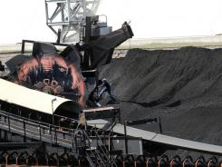 Among tentative regulations still under White House review are rules governing certain emissions from coal-powered plants.