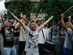 Government at crossroads: Romanians gathered early this month to demonstrate in downtown Bucharest amid political crisis.