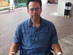USA TODAY correspondent Brian Mansfield leaves a Nashville hospital on July 20 after having much of his colon removed.