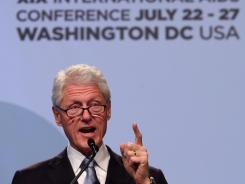 Former president Bill Clinton delivers closing remarks at the 19th International AIDS Conference on Friday in Washington.