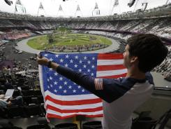 Ryan Musgrave of Chicago holds a U.S. flag before Friday's opening ceremony of the 2012 Summer Olympics in London.