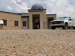 A worker walks out of the construction site of a mosque being built in Murfreesboro, Tenn.