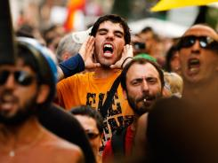 Protesters demonstrate against the country's near 25% unemployment rate and stinging austerity measures introduced by the government in Madrid on Saturday.