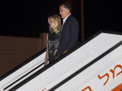 Mitt Romney and his wife, Ann, arrive in Tel Aviv, Israel.