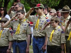 Saluting the flag: Boy Scouts members during a Memorial Day ceremony in Hudson, Wis.