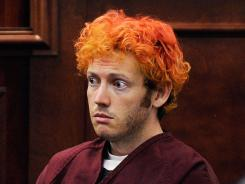 Accused of killing 12: James Holmes appears in court in Centennial, Colo., last week.
