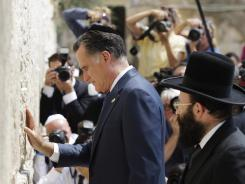Mitt Romney pauses next to the Western Wall in Jerusalem on Sunday.