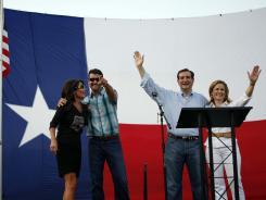 Sarah Palin, far left, stands with her husband, Todd, and Ted Cruz, Texas candidate for the U.S. Senate, and his wife, Heidi, on Friday in The Woodlands, Texas.