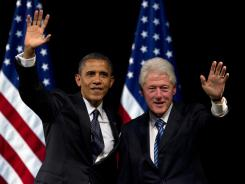 President Obama and former president Bill Clinton wave to the crowd during a campaign event at the New Amsterdam Theater in New York June 4.