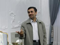 Iranian President Mahmoud Ahmadinejad gestures prior to a meeting at his office in Tehran, Iran, on July 4.