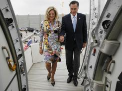 Mitt Romney and his wife Ann board their charter plane Monday in Tel Aviv as they travel to Poland.