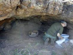 A man extracts artifacts found in mountainous alcoves of southern Arizona.