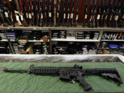 An AR-15 rifle is displayed at the Firing Line indoor range and gun shop in Aurora, Colo.