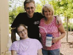 Aimee Copeland, left, with her parents, Andy and Donna Copeland, outside Doctors Hospital in Augusta, Ga.