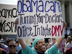 Outside the Supreme Court: An opponent of the new health care law demonstrates in June.