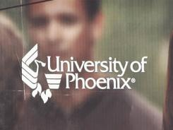 A University of Phoenix billboard is shown in Chandler, Ariz.