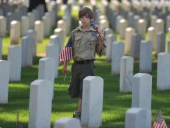 Memorial Day observance: Boy Scout Matthew Russell, 11, in Memphis on May 26.