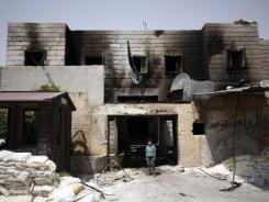 A Syrian boy stands in the rubble of a destroyed police station at the border town of Azaz, north of Aleppo, Syria, on Sunday.